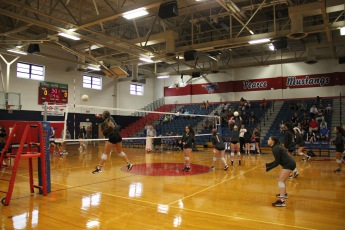 Pearce varsity volleyball going against Heritage  Hight School.